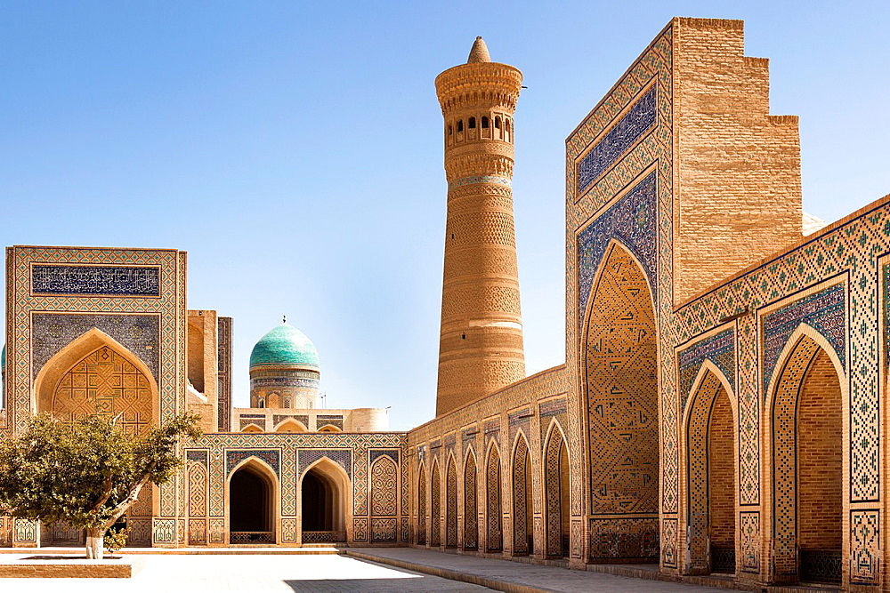 Kalon Mosque courtyard, also known as Kalyan Mosque, Kalon Minaret and Mir I Arab Madrasah behind, Bukhara, Uzbekistan.