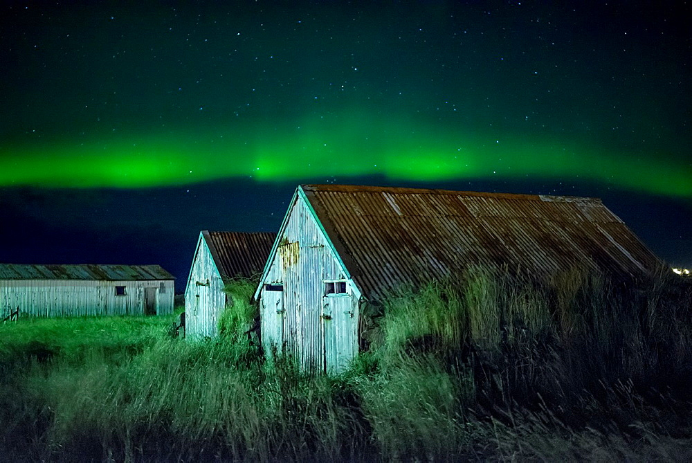 Long exposure with houses foreground and northern lights. Iceland.