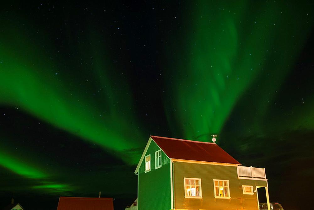 Northern lights in Reyjanesta harbour, Iceland.