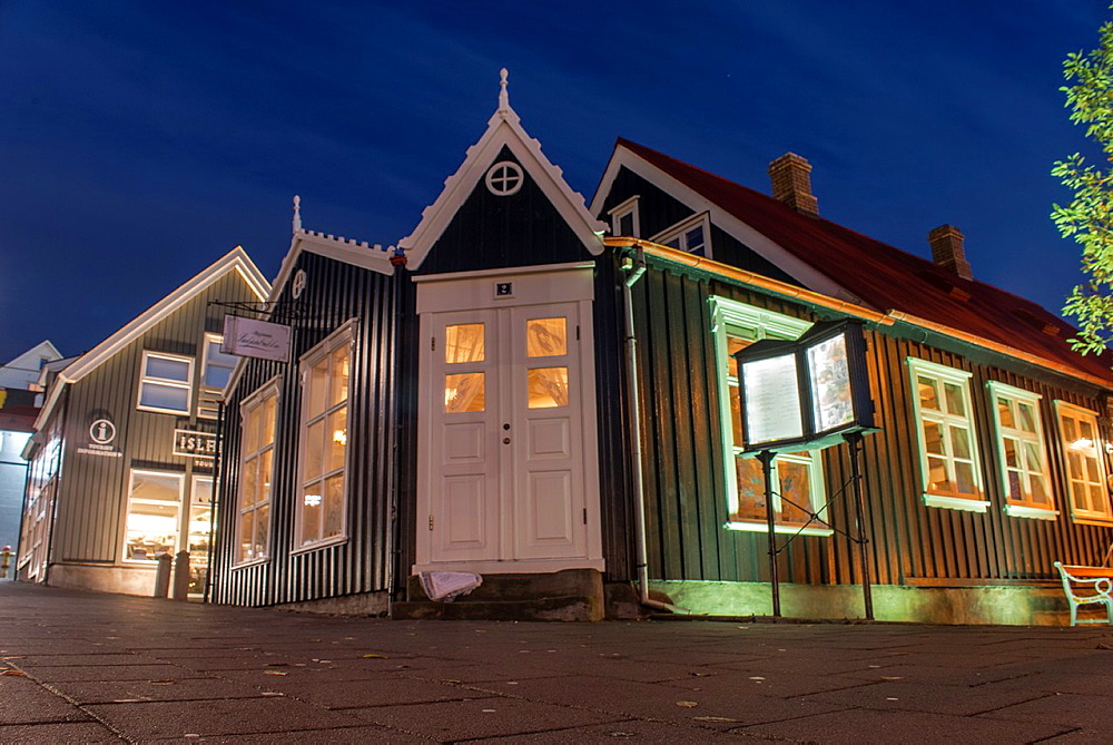 Iluminated streets of Reykjavik old town, city centre by night. Iceland.