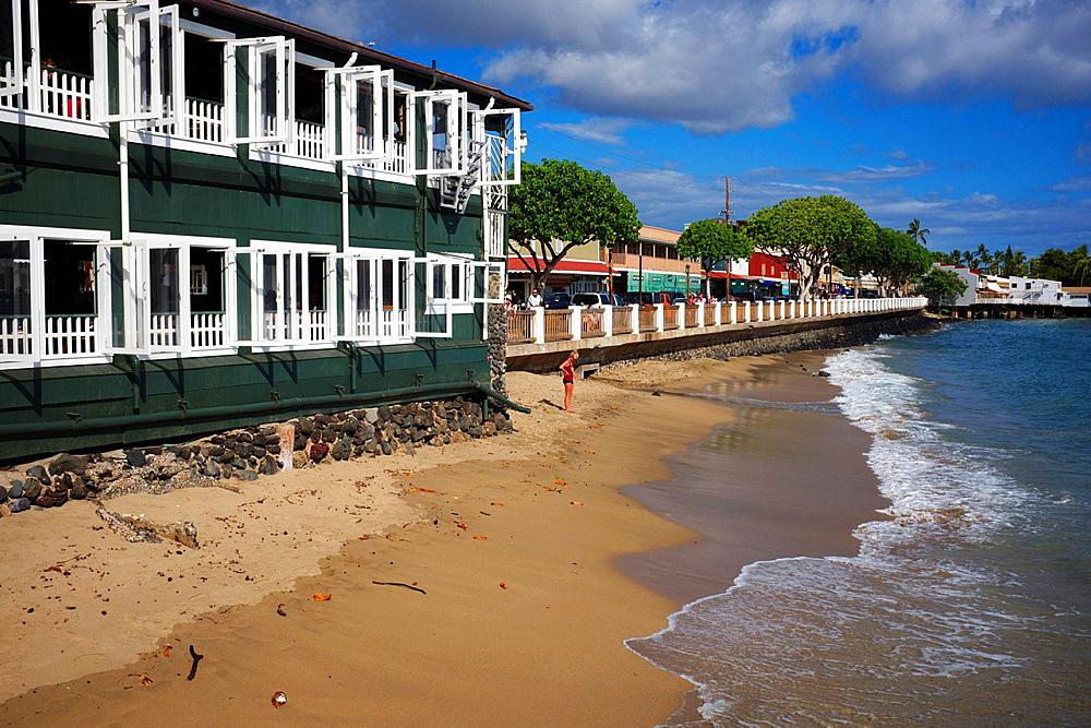 Popular cruise ship destination, the historic port of Lahina in Maui, Hawaii at sunset