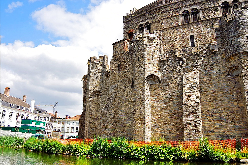 Gravensteen, the Castle of the Counts of Flanders, originally built in the year 1180 and rebuilt several times since, seen from a boat tour. Ghent, Belgium.