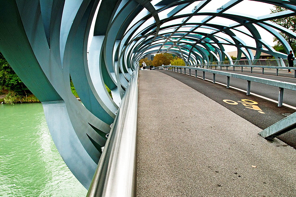 bridge crossing Arve river in Geneva named after Hans Wilsdorf, the founder of Rolex, bridge is called 'bird's nest' because of its interwoven girders.
