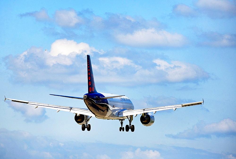 Rear view of passenger jet liner landing in Geneva airport