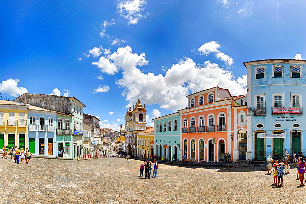 Brazil, Bahia, Salvador, Pelourinho: The triangular plaza Largo do Pelourinho within Salvador de Bahia's beautifully restored historic center of Pelourinho. --- Info: The district Pelourinho was built by the Portuguese in the 18th and 19th century as a residential and administrative center. Neglected for a greater part of the 20th century, Pelourinho received in 1985 the status as a UNESCO World Heritage Site. Restored it is today the crown jewel of Salvador. - 817-468912