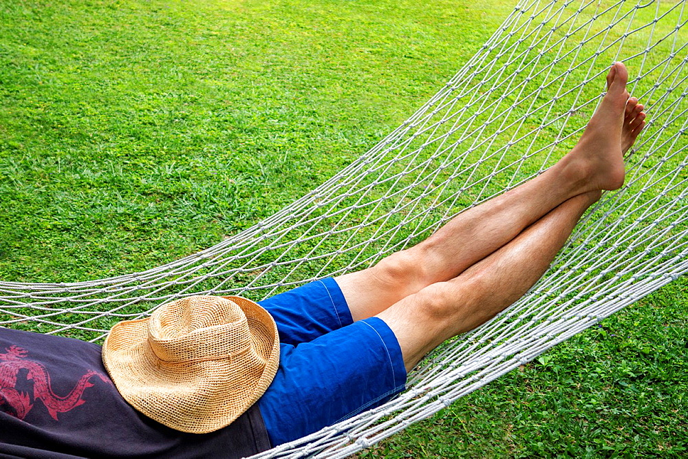 Adult male relaxing in a hammock.