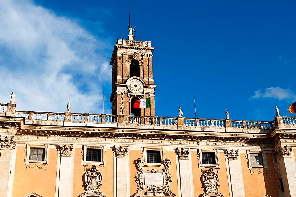 Clock tower with Italian flag, Palazzo Senatorio at Piazza del Campidoglio, Capitoline Hill, Rome, Italy.