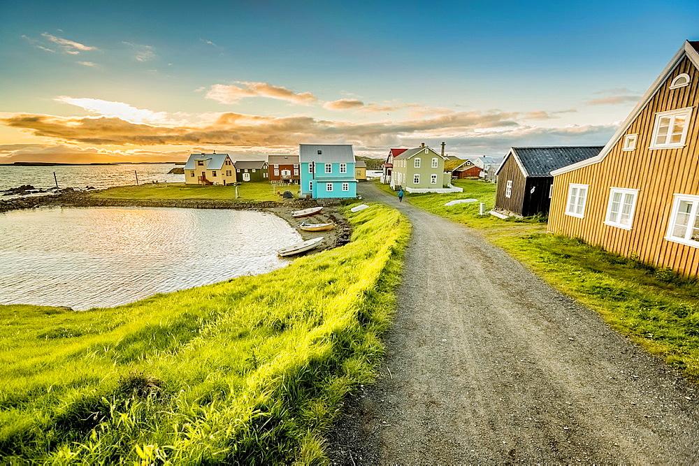 Coastline and summer houses, Flatey Island, Borgarfjordur, Iceland.