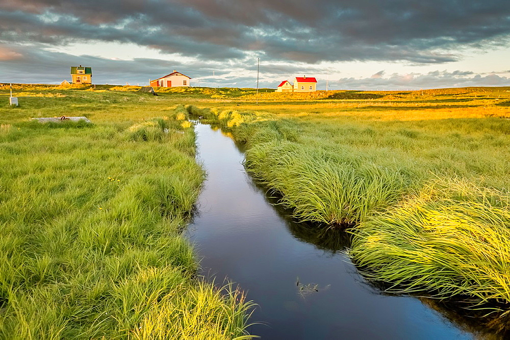 Marshland and summer houses, Flatey Island, Borgarfjordur, Iceland.