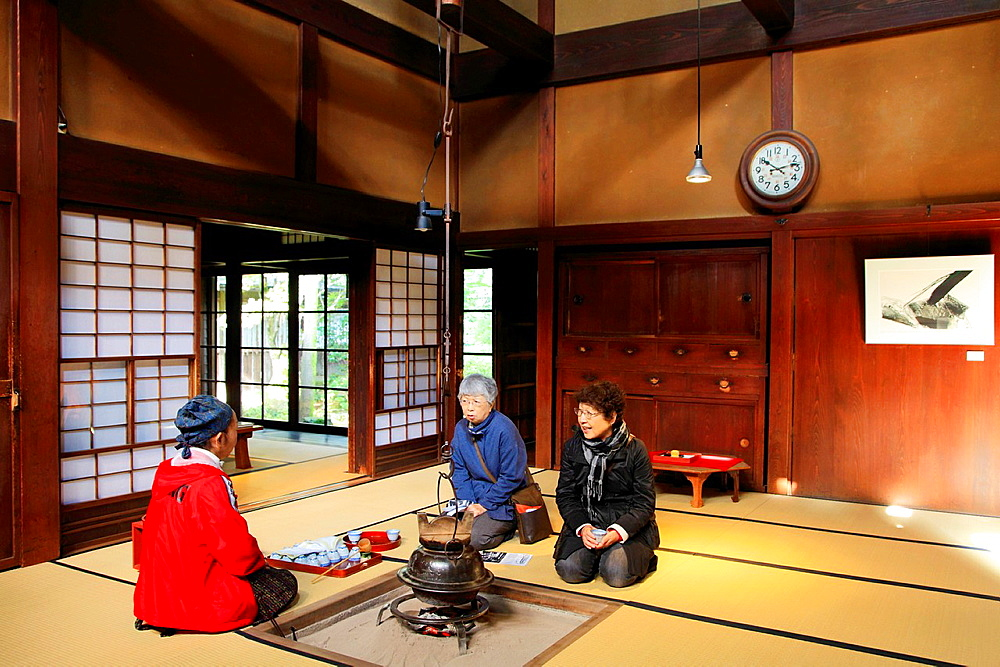 Japan, Hida, Takayama, Kusakabe Heritage House, interior, women drinking tea,.