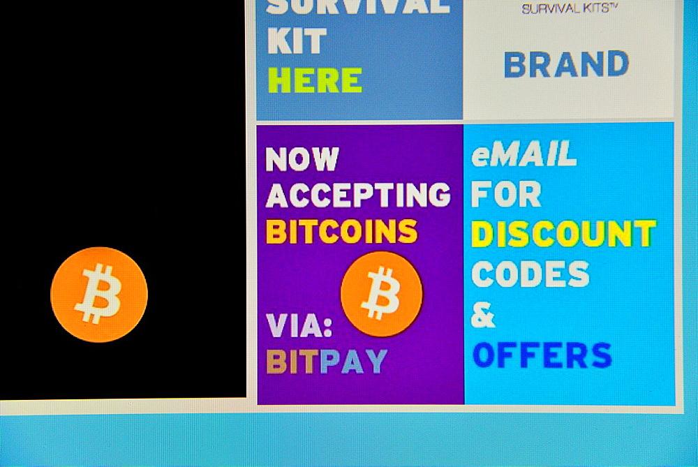 accepting bitcoin sign at website at computer