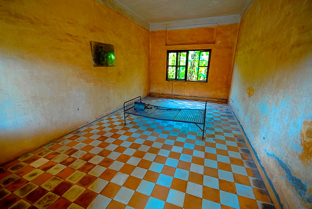 torture room with bed in formerly prison Tuol Sleng at Phnom Penh, Cambodia