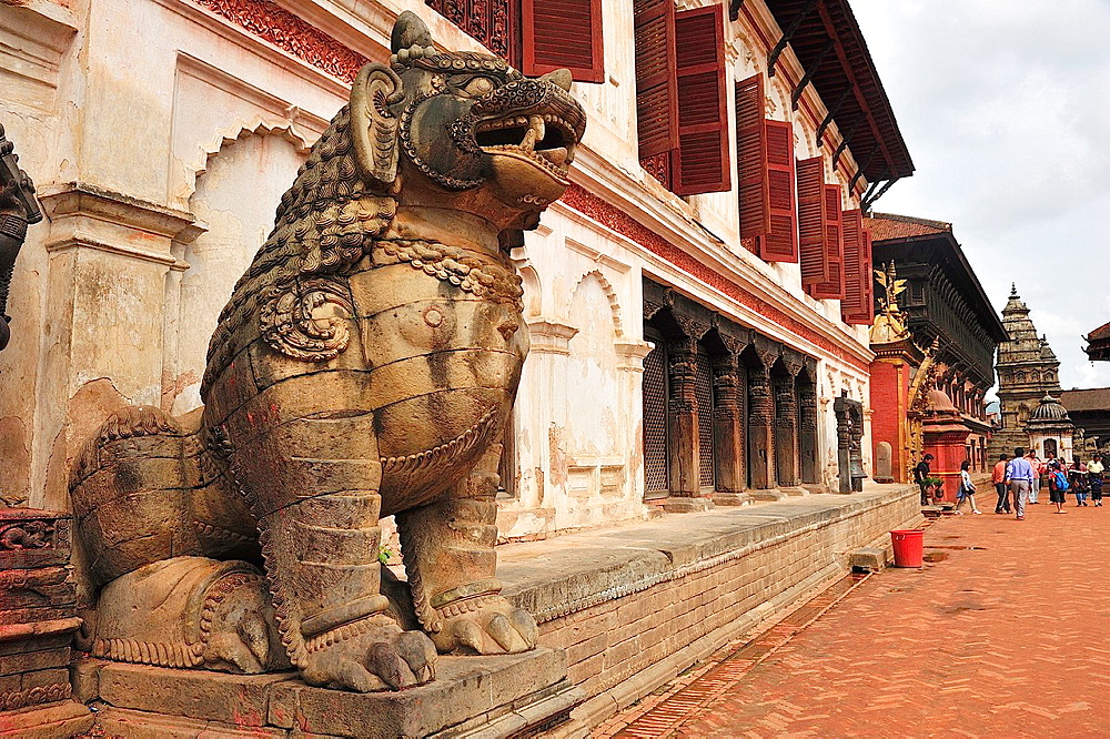 Lion in stone at entrance of National Art Gallery, Durbar Square, Bhaktapur, Nepal