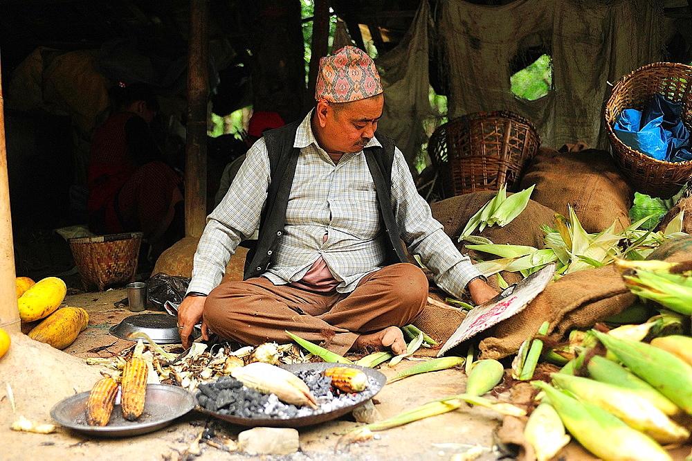 Roasting corn close to Dakshinkali Temple in Dhasain Festival, Kathmandu Valley, Nepal