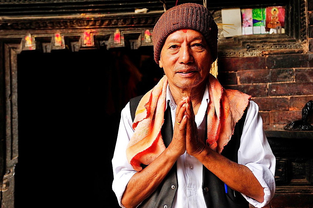 Greeting ritual of a Buddhist man, Bhaktapur, Nepal