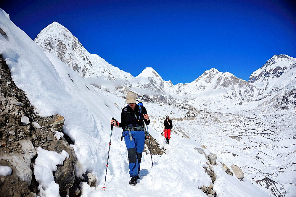 Hikers on Khumbu Glacier, Sagarmatha National Park, the Himalaya range
