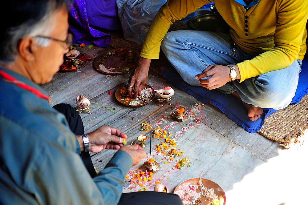 Buddhists believer getting offering, Buddhist Golden Temple, Patan, Nepal