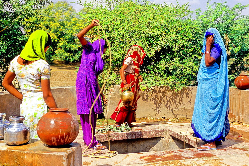Women getting water from a well, Uttar Pradesh state, India