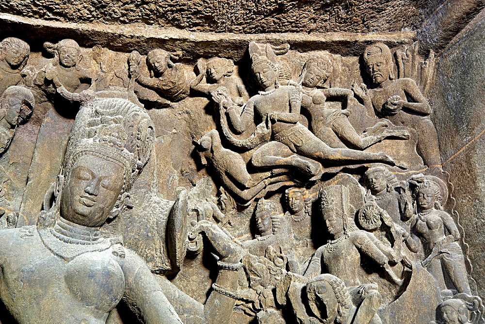 Cave 1 : Elephanta Caves. Right portion of Ardhanarishwar-Gandharvas offering garlands and paying obeisance to the lord. Maharashtra, India.