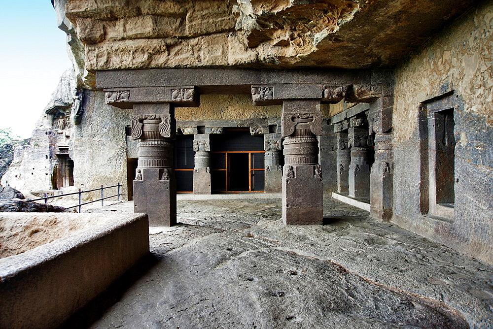Cave No. 6 Pillared porch. Square base with leaves and foliage at the top. Ellora Caves, Aurangabad, Maharashtra India.
