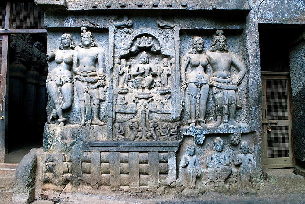 Mithuna couples on right of entrance of Chaitya hall. Intrusive Buddha image in between. Karla Caves, Pune district, Maharashtra India.