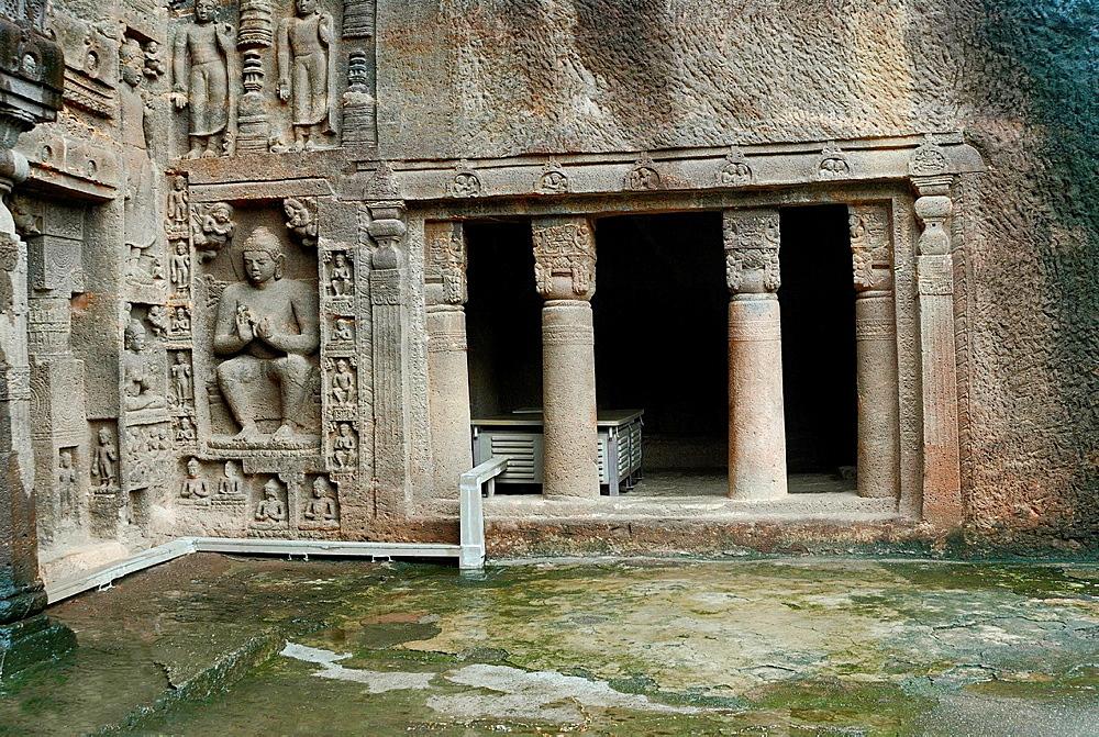 Cave 19 : Right wing of Facade. Left of facade showing intrusive Buddha image. Ajanta Caves, Aurangabad, Maharashtra, India.