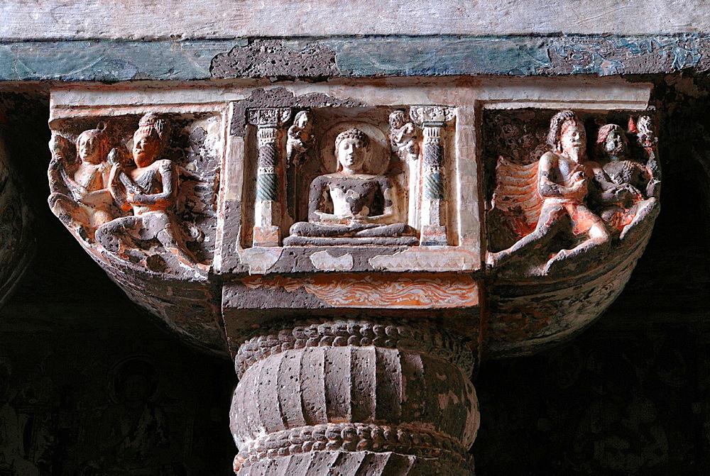 Cave 19: Mid Shot of pillar capital detail, showing Buddha seated in Padmasana. Ajanta Caves, Aurangabad, Maharashtra, India.