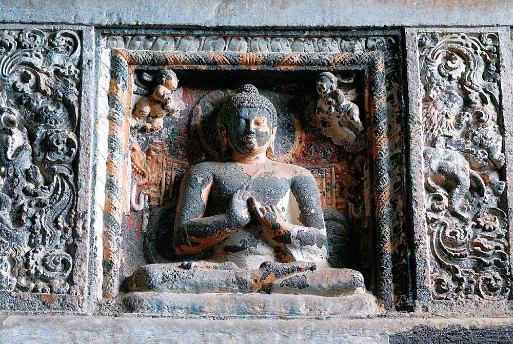 Cave 19 : Interior. Architrave showing one of the Buddha image in Padmasana. Ajanta Caves, Aurangabad, Maharashtra, India.