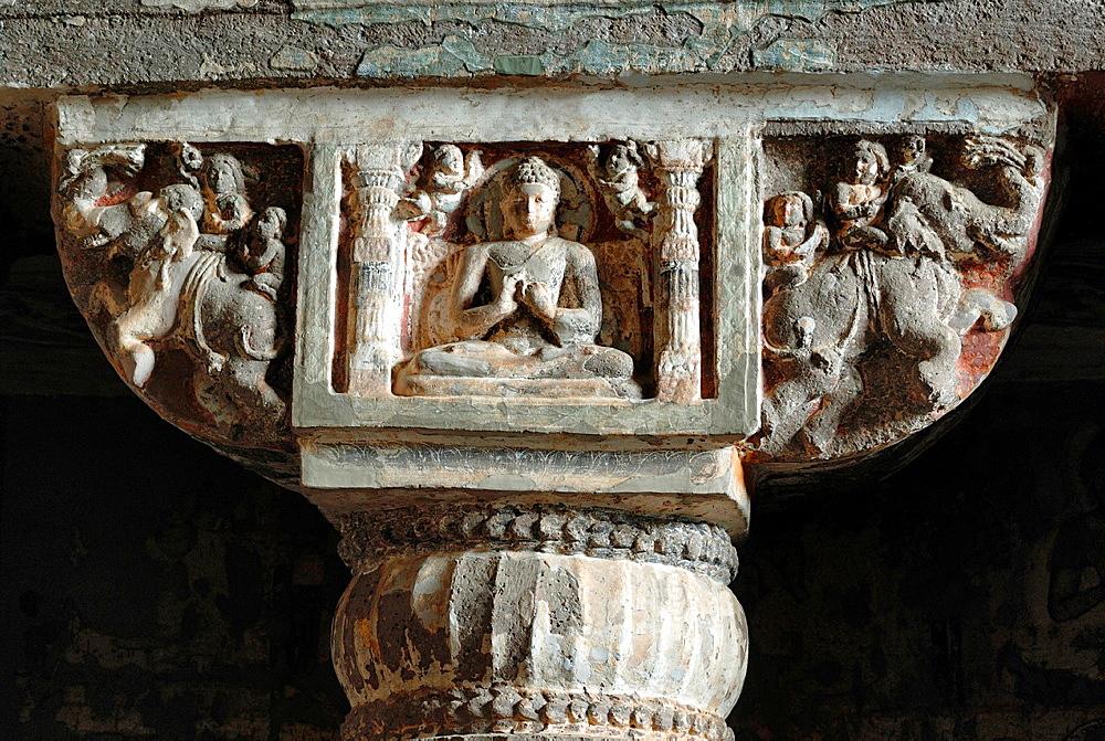 Cave 19 : Pillar capital in the interior. Central portion shows Buddha in Padmasana. Ajanta Caves, Aurangabad, Maharashtra, India.