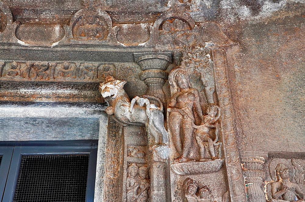 Cave No 4: Sculpture on the right of doorway shows tree goddess with attendant. Ajanta Caves, Aurangabad, Maharashtra, India.