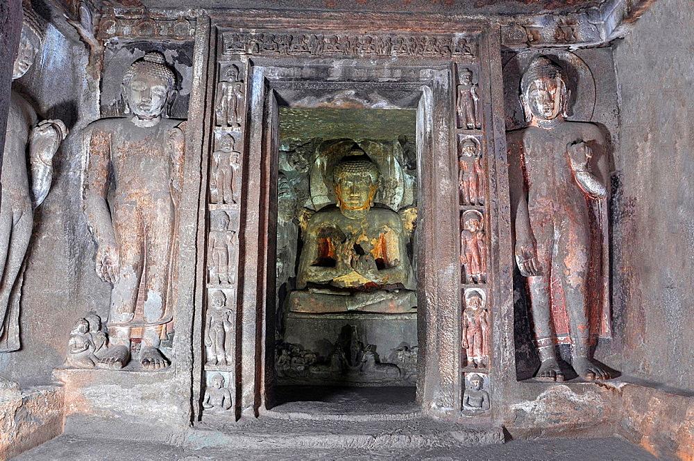 Cave 4 : Buddha in shrine with two colossal Buddha images on either side. Ajanta Caves, Aurangabad, Maharashtra, India.