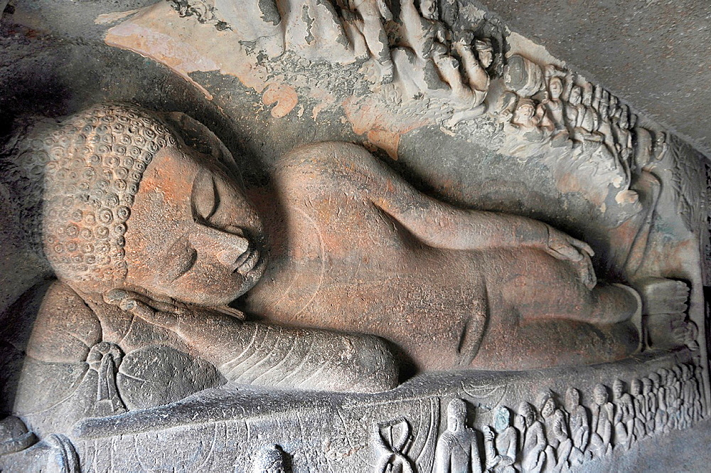 Cave 26: Reclining Buddha with his right hand resting below the face on the cushion. Ajanta Caves, Aurangabad, India.