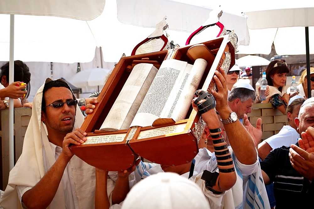 Jewish Child showing the Torah scroll Bar Mitzvah in Western Wall Jerusalem.