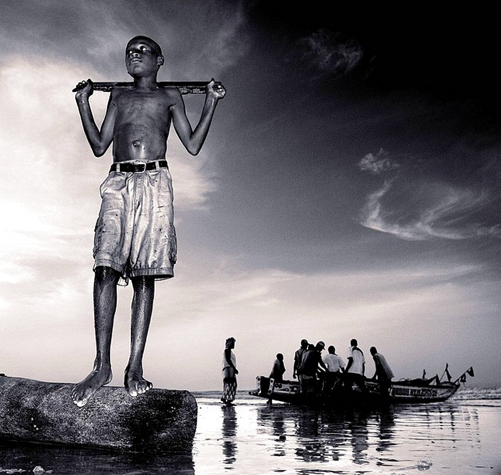 Young fisherman in the evening, Gambia