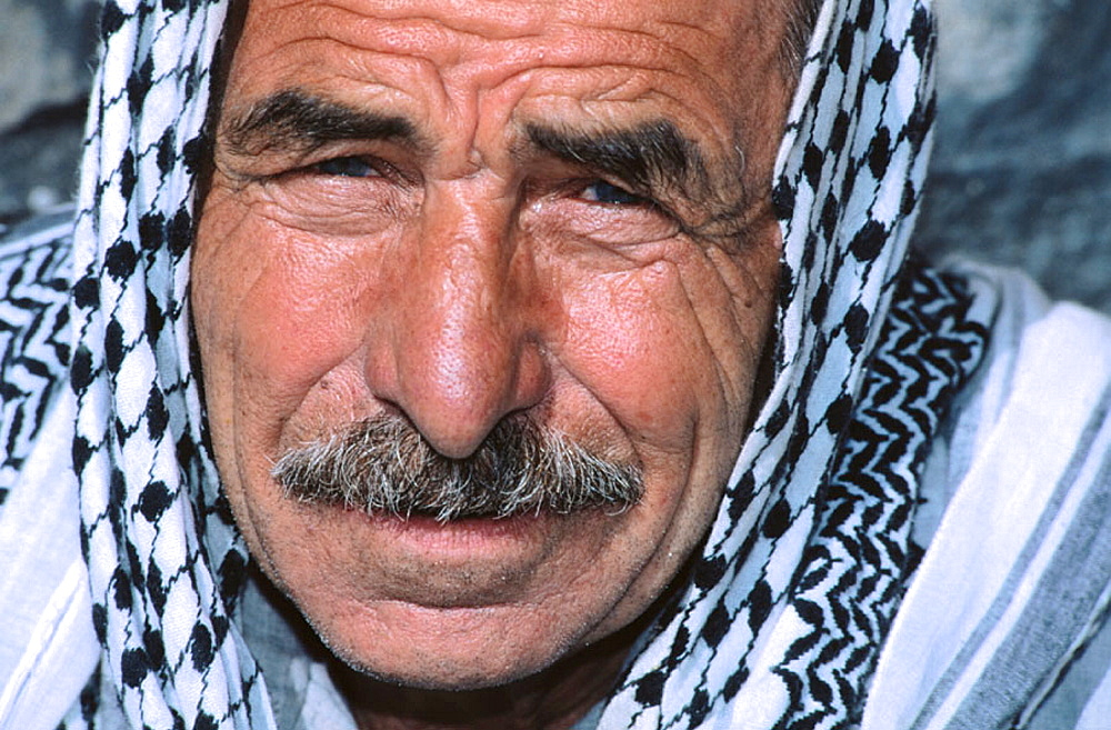 Portrait of a man with a kefieh in Hama, Syria