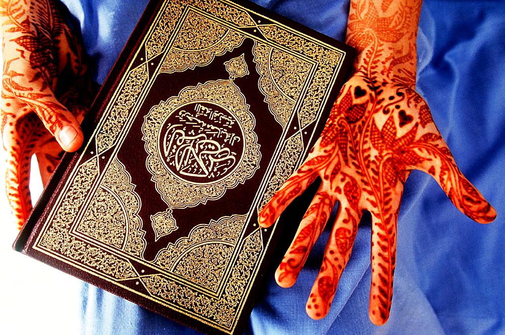 Koran and henna painted hands, Morocco