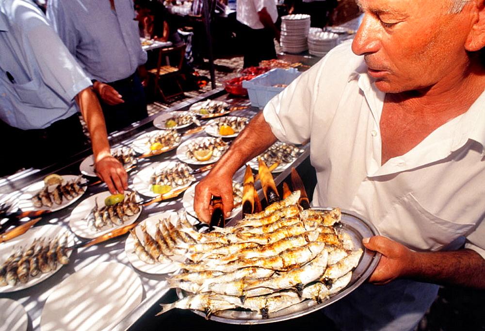 Food: 'Espeto de sardinas' (grilled sardines) at El Tintero restaurant on Malaga beach, Malaga, Andalucia, Spain.