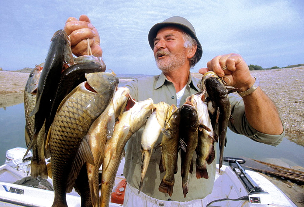 A day fishing in the Caspe lake on the Ebro river, Zaragoza province, Spain.