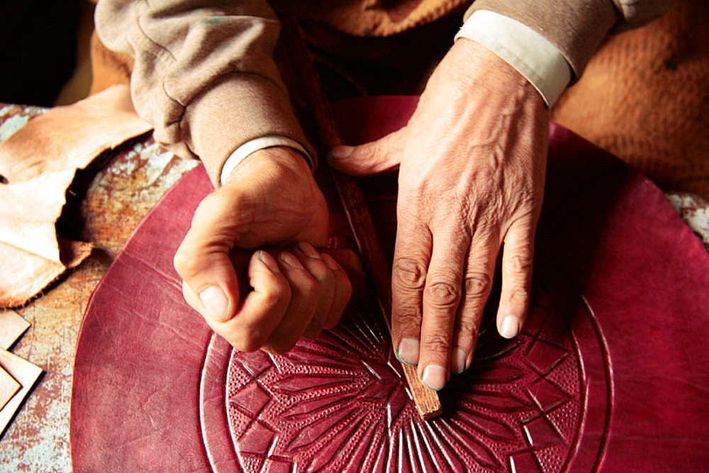 At a leather workshop in the Medina of Fes, Morocco.