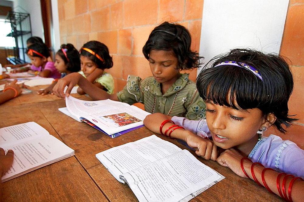 Study and reading time, Mary Matha Bala Bhavan, a girls' orphanage run by Syro-Malabar Catholic Missionary Sisters of Mary Immaculate (MSMI), Chamal village, Thamarassery Diocese, Khozikode, Kerala, India