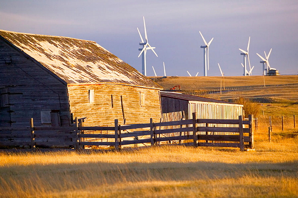 Cowley Ridge wind farm landscape with old ranch, Crowsnest Pass area, Alberta, Canada