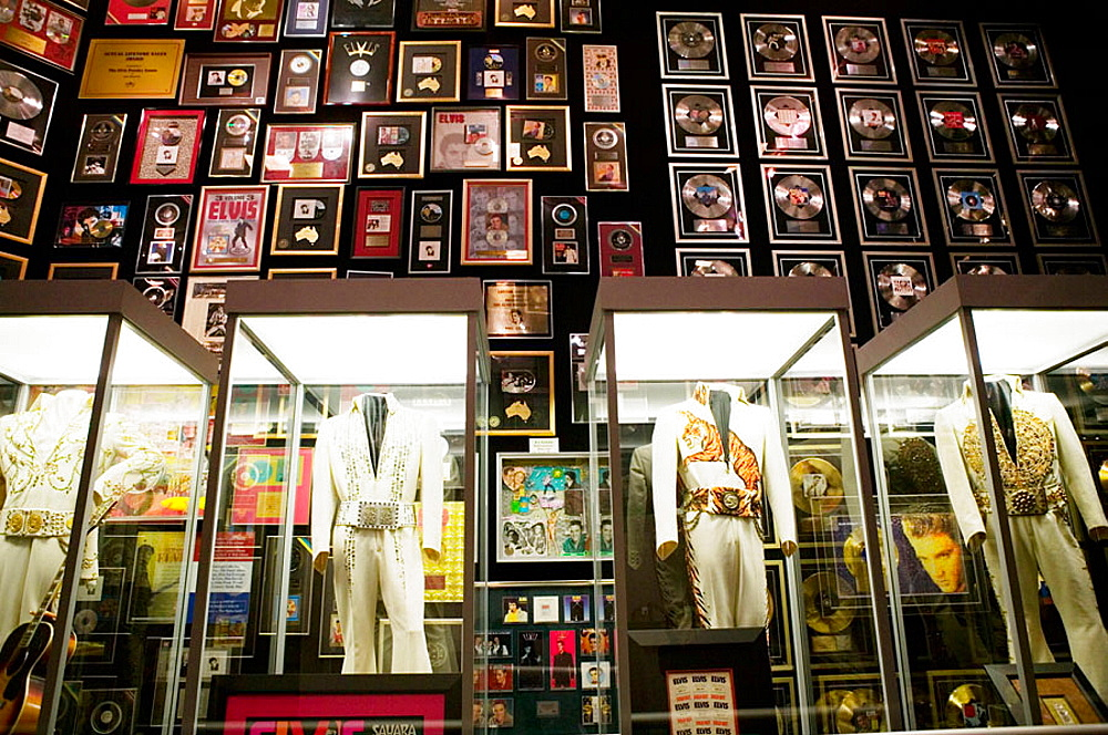 Elvis Presley's  Las Vegas Costumes & gold records, Former Residence of Elvis Presley, Graceland, Memphis, Tennessee, USA