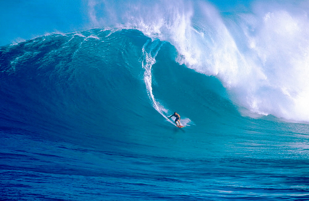 Surfing Jaws, a 30 wave on the north shore of Maui, Hawaii