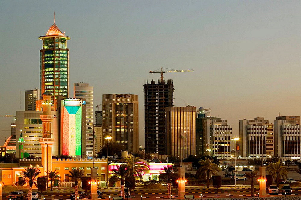 KUWAIT-Kuwait City: Dar Al-Awadi Building and Mosque / Downtown /  from  Sharq Souk Marina / Evening