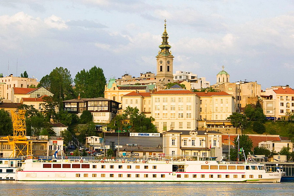 Serbia, Belgrade, Danube River Barges and Stari Grad (Old Town) / Sunset