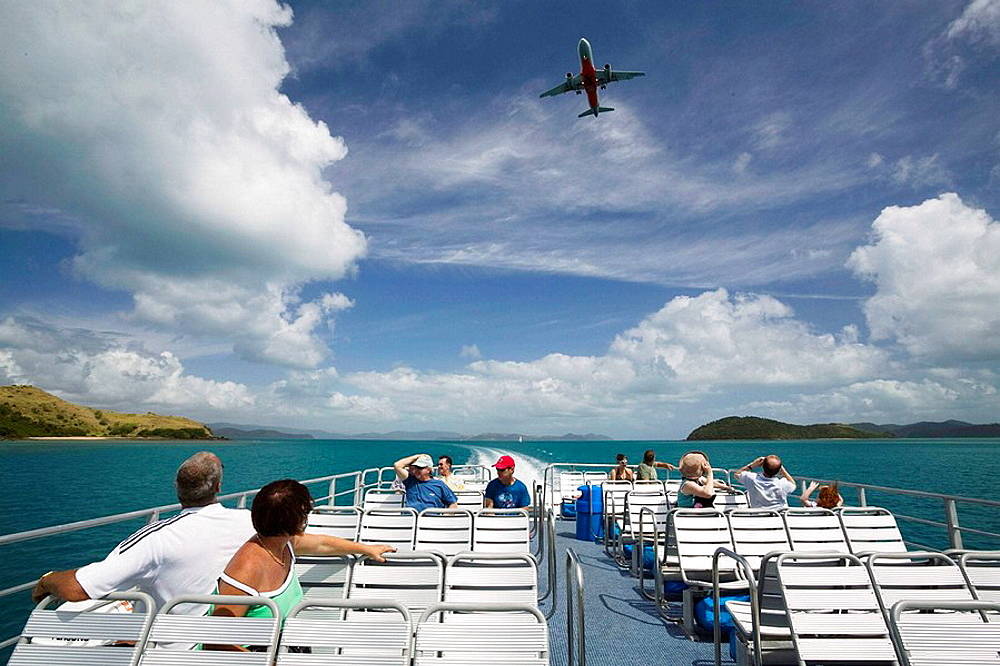 Australia - Queensland - Whitsunday Coast - Hamilton Island: Aboard the Hamilton Island Ferry with Airliner in landing path