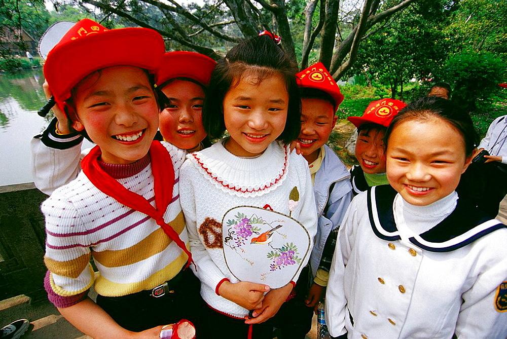 School children at West Lake park, Hangzhou, Zhejiang province, China