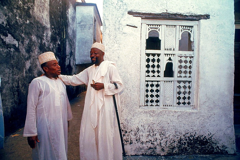 Men chatting before attending a great wedding, Grande Comore, Comoros
