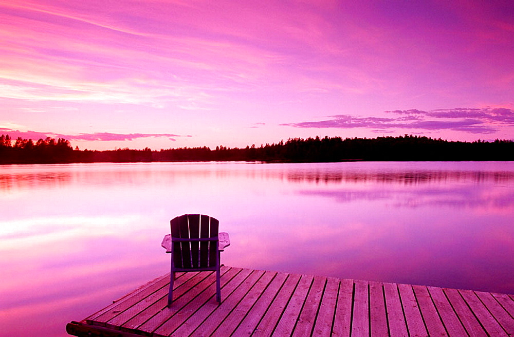 Lifestyles, Early dusk, Adirondack chair at lake, Near Anchorage, Southcentral Alaska, USA.