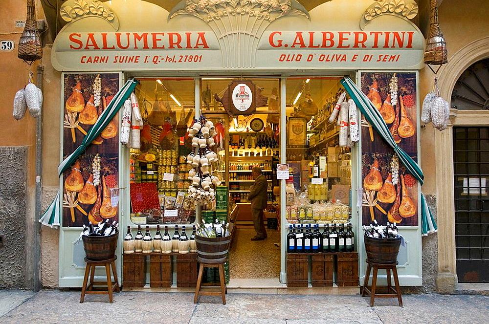 Italy, Verona, Shopfront selling wine, olive oil, meats, etc.